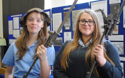 The girls try out some painfully heavy, genuine military equipment